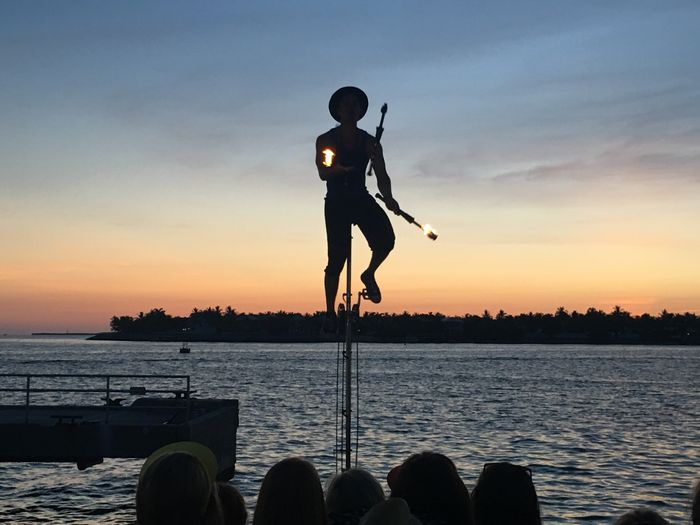 View of fire performer at sunset