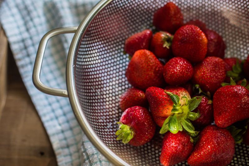 High angle view of strawberries in container on table