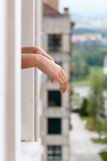 Human hand against built structure