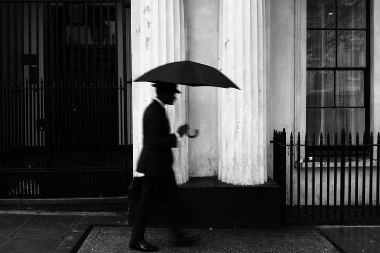 Untitled - check out my new Instagram account RobinPopePhoto Umbrella One Person Protection Real People Side View Security Day Adult Full Length Lifestyles Rain Standing Outdoors Streetwise Photography The Art Of Street Photography The Street Photographer - 2019 EyeEm Awards The Mobile Photographer - 2019 EyeEm Awards