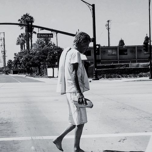 Guy with no shoes Walking City Life Lifestyles Orangecounty  Monochrome Photography