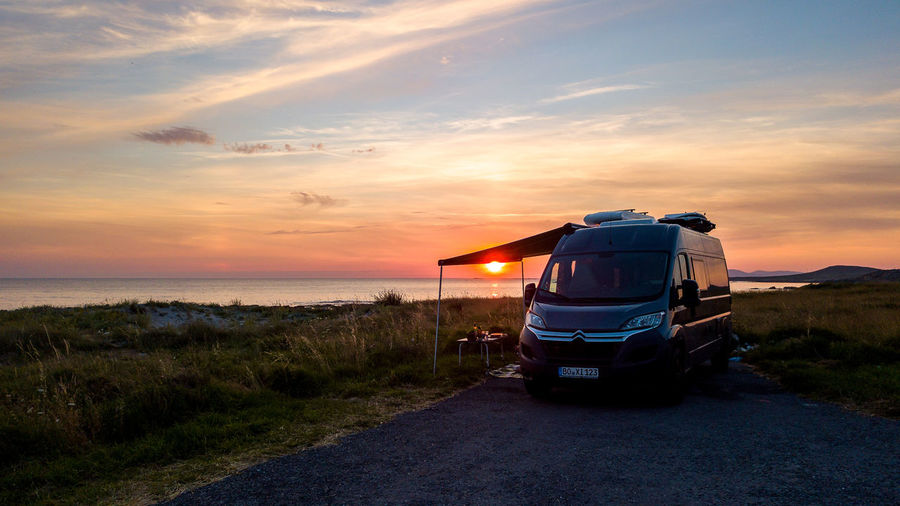 sundowner near the end of the world Vanlife Roadtrippin' Travelmate Sundowner Summer Road Tripping Sunset Rural Scene Water Sea Sky Grass Cloud - Sky