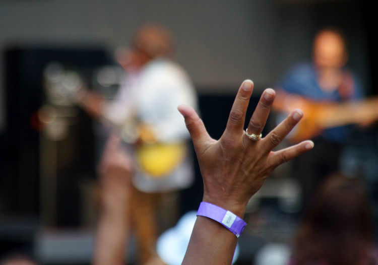 Cropped image of hand at music concert