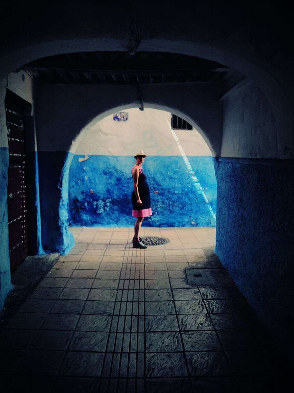 full length, real people, arch, one person, architecture, built structure, indoors, rear view, lifestyles, tunnel, leisure activity, day, standing, young adult, people