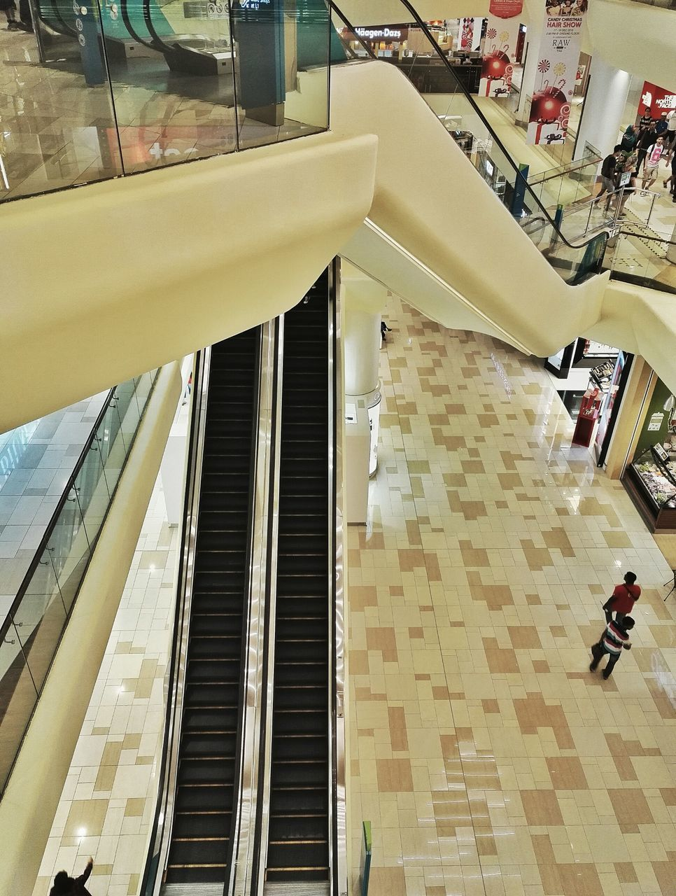 high angle view, retail, real people, architecture, indoors, built structure, steps and staircases, steps, store, men, lifestyles, convenience, day, one person, people
