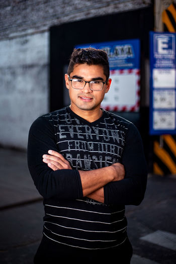 Portrait Young Adult Casual Clothing Lifestyles Streetphotography Street Style Parking Sexyboy Sexyman Fit Fitness Fitnessmodel Handsome Latino Urban Style Urban Clothing Strong Man Neutro Model Pose Eyeglasses  Arms Crossed Muscular Attractive