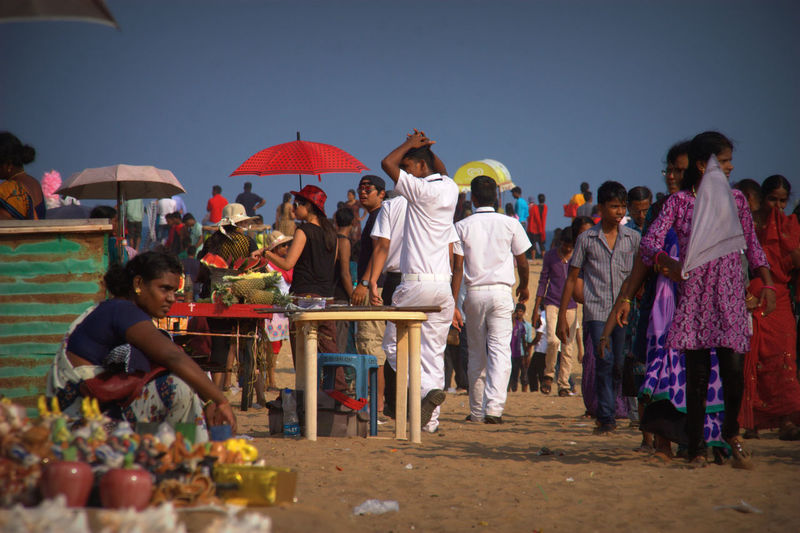 Indian Public Holiday at Mahabalipurham Beach Abundance Beach Casual Clothing Choice Cultures Day Display Group Of People Hawkers India Large Group Of Objects Leisure Activity Lifestyles Market Market Stall Multi Colored Outdoors People Of The Oceans Retail  Sale Small Business Variation