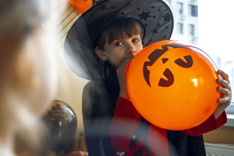 Full length of a boy with pumpkin