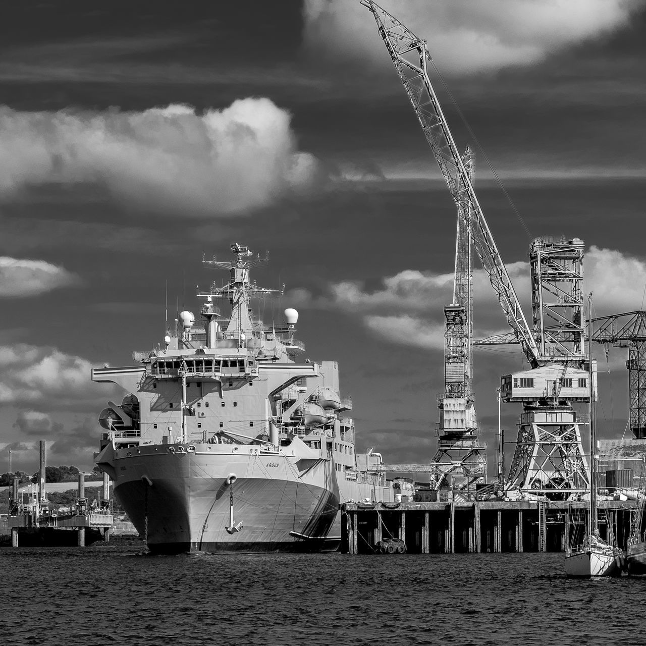 cloud - sky, sky, nautical vessel, water, transportation, industry, built structure, crane - construction machinery, mode of transport, architecture, harbor, outdoors, sea, building exterior, no people, freight transportation, day, commercial dock, shipyard, nature