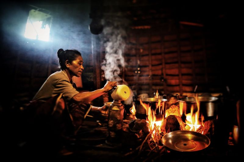 Indigenous woman of Wae Rebo Village in Flores Island, Indonesia. Cooking Fire Indigenous  Kitchen Smoke Tent Travel Travel Photography Village Wae Rebo Waerebo Woman Woman Portrait