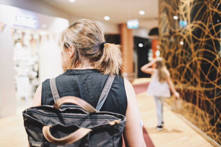 Rear View Customer  Indoors  Store Retail  Purse Real People One Person Blond Hair Day People Young Adult Indoor Indoor Photography Brown Hair Black Top Close-up Woman Full Frame Shopping Mall Shopping Time Active Mother Daughter