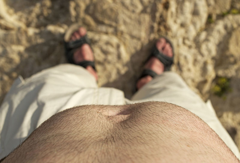 downward view of a man's belly on the beach Bare Downward View Looking Down Man Standing Beach Belly Close-up Closeup Directly Above Human Body Part Low Section Male Outdoors People Real People Sand Selective Focus Tummy