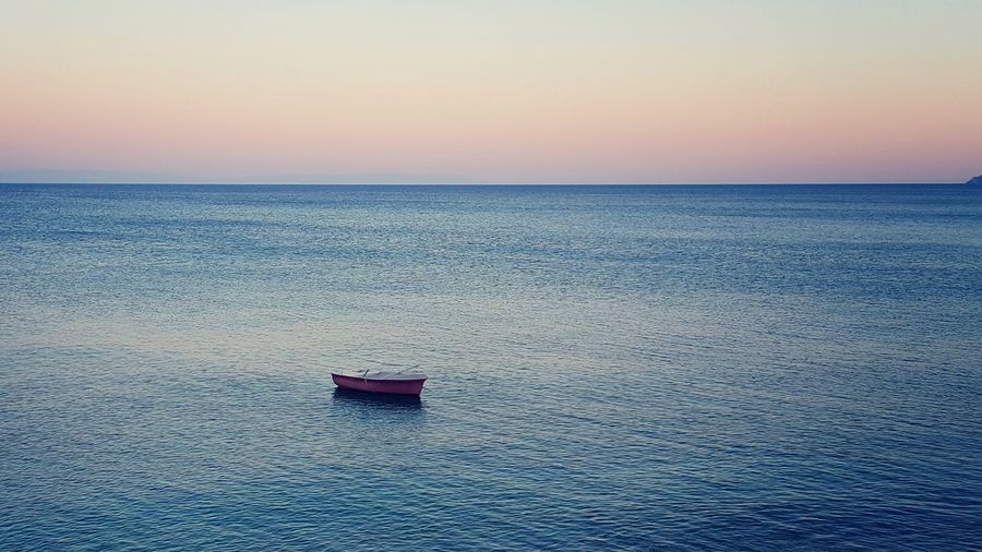 High Angle View Of Fishing Boat In Sea Against Sky