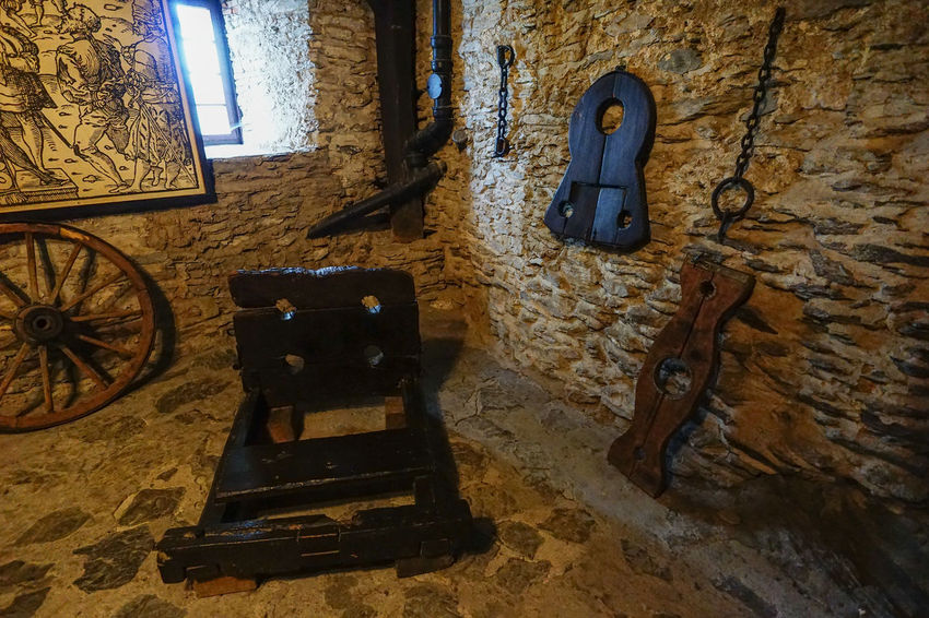 dungeon, punishment instruments in Marksburg Castle Abandoned Absence Antique Architecture Brick Wall Building Exterior Built Structure Crime And Punishment Day Devices House Indoors  Iron Marksburg Medieval Metal Obsolete Old Old-fashioned Torture Wall Wall - Building Feature Wheel Window Wood