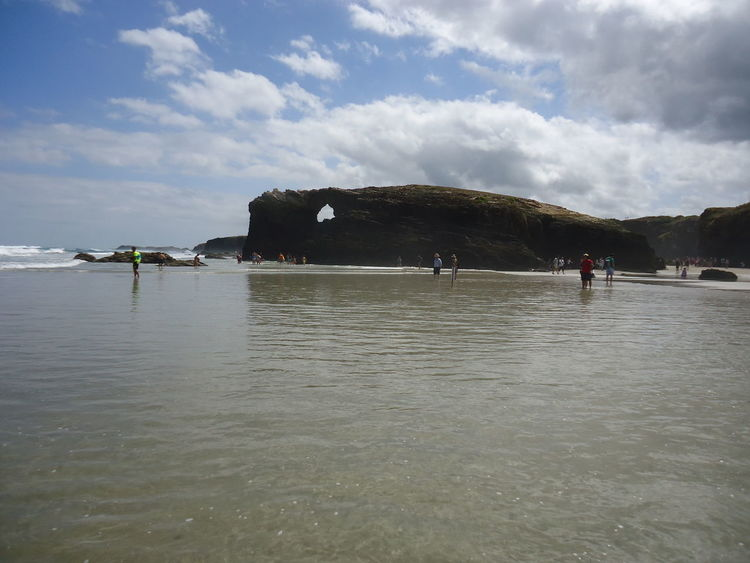 Playa de las Catedrales, standing in low tide water. Atlantic Ocean Bay Of Biscay Beach Biscayne Bay Blue Sky Blue Sky And Clouds Breakers Clear Water Famous Place Galicia Low Tide Ocean Playa De Las Catedrales Rock Formation Rocks Shore