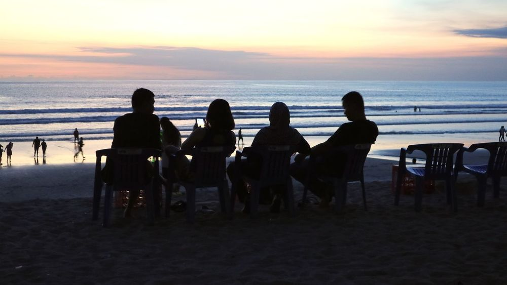 Kuta Beach Denpasar. Bali. Indonesia Beach Beauty In Nature Day Horizon Over Water Large Group Of People Leisure Activity Men Nature Outdoors People Real People Sand Scenics Sea Silhouette Sitting Sky Sunset Togetherness Tranquility Vacations Water Women