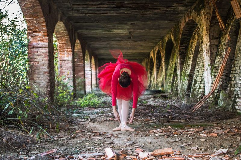 Portrait of ballerina underneath bridge