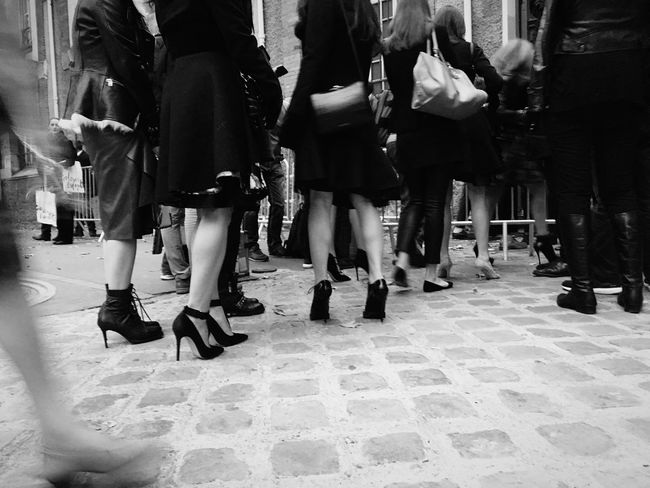 Fashionistas queue outside a Fashion Show at Paris Fashion Week SS16 Heels shot on IPhone 6s