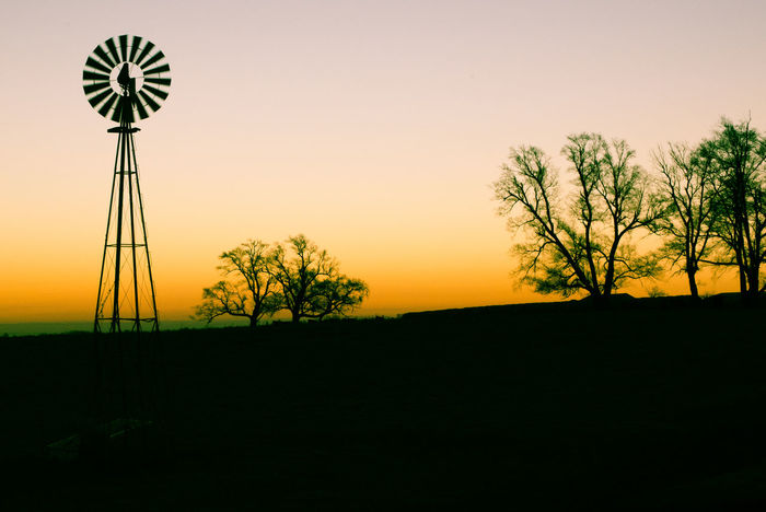 Morning windmill silhouette Alternative Energy Beauty In Nature Clear Sky Day Environmental Conservation Field Fuel And Power Generation Industrial Windmill Landscape Nature No People Outdoors Renewable Energy Rural Scene Scenics Silhouette Sky Sunrise Sunset Traditional Windmill Tranquility Tree Wind Power Wind Turbine Windmill