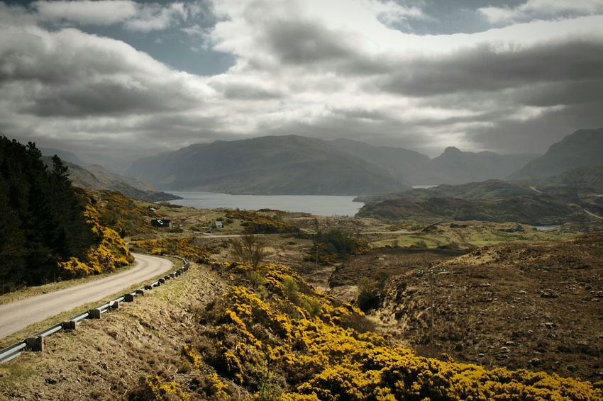 North Coast 500 Scotland Coast Winding Road Road Trip Road To Nowhere Driving Clouds Water Scenics Outdoors Heather Sky Highlands Loch  Tree Landscape The Great Outdoors - 2017 EyeEm Awards Dramatic Sky Mountain Cloud - Sky No People Beauty In Nature Nature Road