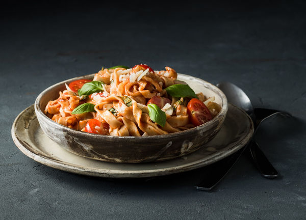 fresh homemade pasta served with basil and tomatoes in a ceramic bowl on a dark background | daylight foodphotography martin willmann Basil Homemade Black Background Bowl Ceramic Ceramics Close-up Daylight Photography Food Food Photography Foodphotography Freshness Italian Food Light And Shadow negative space Nikonphotography No People Pasta Ready-to-eat Serving Size Still Life Tomatoes Vegetable Vegetarian Food