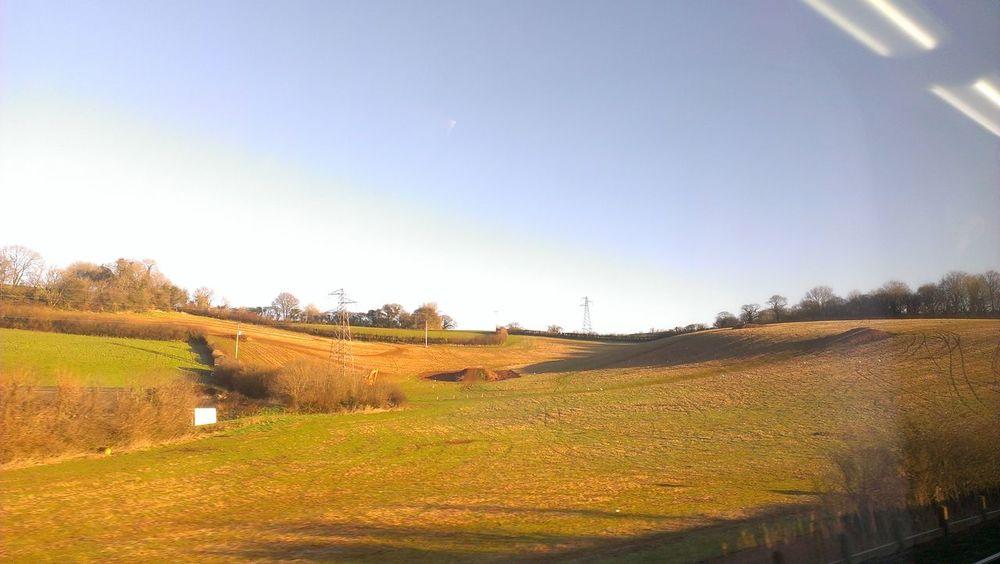 Brown Plowed Train Journey Hillside