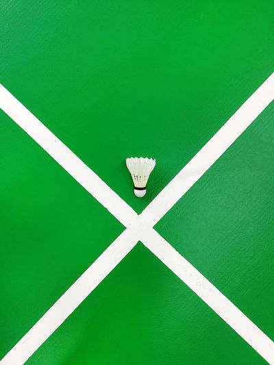 High angle view of paper on green background