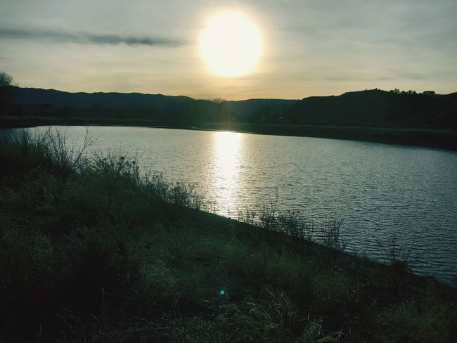 Sun reflecting on lake. Scenics Sunset Tranquil Scene Nature Beauty In Nature Water Tranquility Sky Reflection Sun Lake No People Mountain Outdoors Sunlight