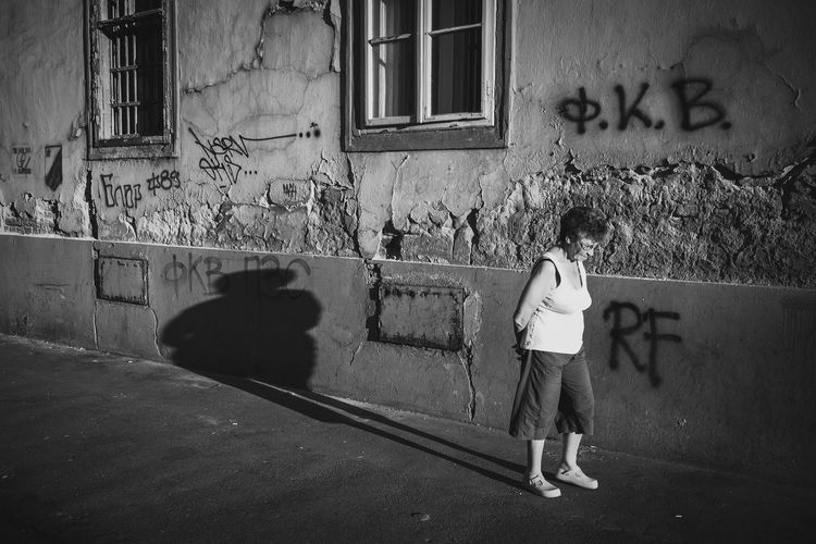 Architecture Building Exterior Built Structure Day Older Woman One Person Outdoors People Real People Shadow Standing Streetphotography The Street Photographer - 2017 EyeEm Awards Window