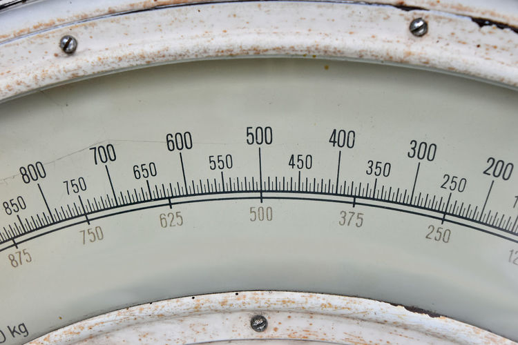 Close-up of old weight scale