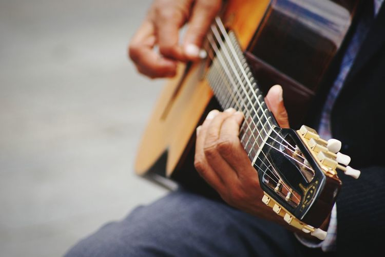 Hanging Out Taking Photos Enjoying Life Having Fun :) Music Guitar Musician Musical Instruments Guitarist Hands Focus On Foreground Street Photography Street Musician