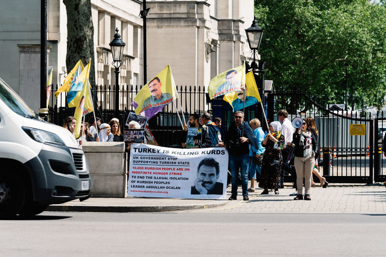 Kurdish demonstrators in front of Downing Street gate against British support for Turkey Abdullah Ocalan Apo London Pkk Patriotism Turkey Uk Activist  Banners British Communist Concept Conflict Country Democracy Demonstration Demonstrator Downing Street Europe Flag Freedom Genocide Government Kurd Kurdish Kurdistan Leftist Middle East Muslim National Nationalism Organization Patriotic People Political Politics Protest Protester Protesters Referendum Revolution Street Demonstration Symbol Terrorist Turkish Turkish Election War Large Group Of People