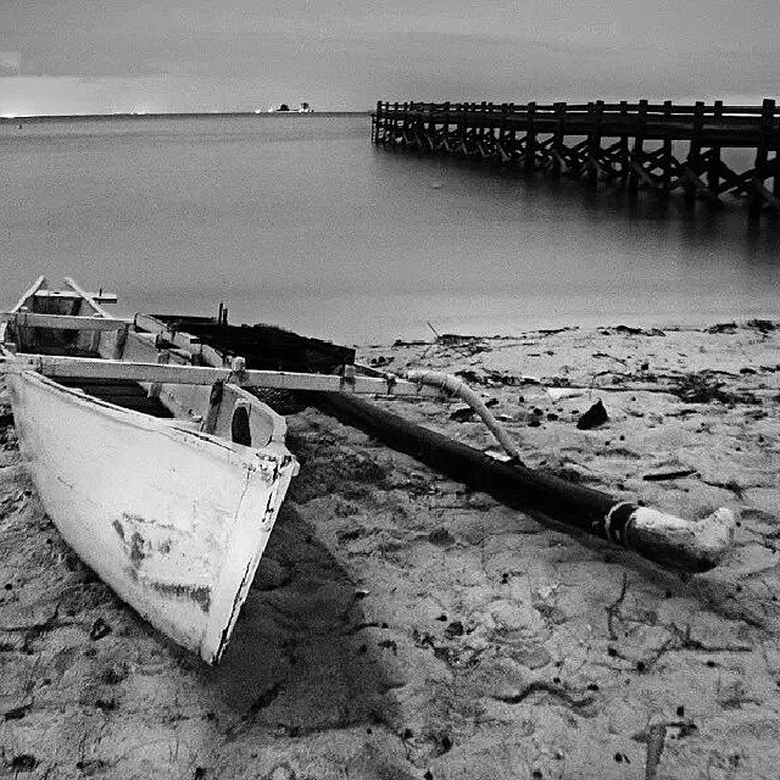 nautical vessel, moored, transportation, water, boat, mode of transport, sea, beach, pier, shore, abandoned, harbor, nature, wood - material, sky, outdoors, day, no people, tranquility, damaged