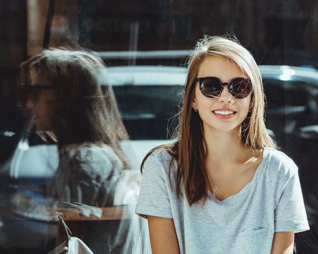 Beautiful People Beauty Blond Hair Casual Clothing Front View Girl Glass Glasses Headshot Leisure Activity Lifestyles Long Hair Looking At Camera Person Reflection Smile Street Two Is Better Than One Young Adult Young Women