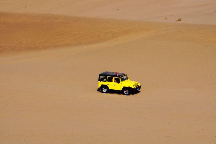 High Angle View Of Yellow Car On Desert