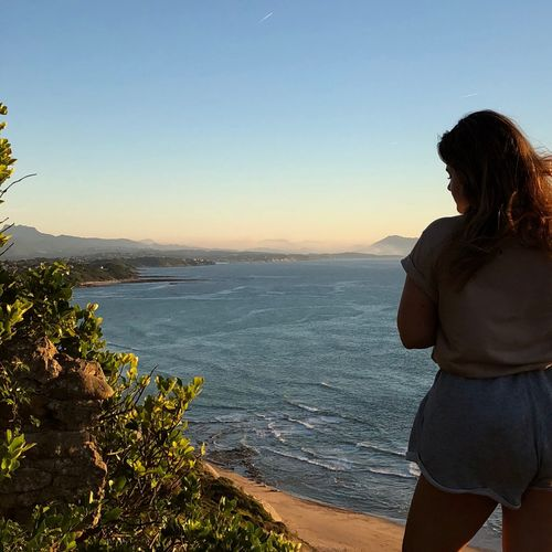 Water Sky Beauty In Nature Sea Scenics - Nature Leisure Activity Lifestyles One Person Nature Real People Tranquility Beach Land Tranquil Scene Standing Rear View Women Three Quarter Length Outdoors Looking At View