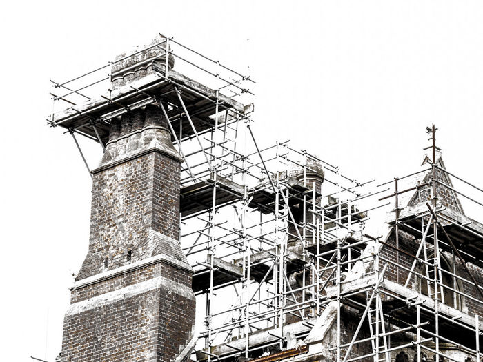 scaffolding Apartment Architecture Building Building Exterior Built Structure City Clear Sky Construction Industry Construction Site Copy Space Day Development Industry Low Angle View Nature No People Outdoors Scaffolding Sky Tall - High Travel Destinations