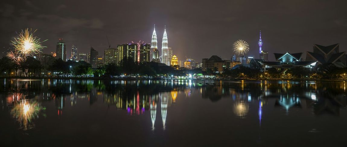 Expecting more fireworks but getting small ones instead. HAPPY NEW YEAR FOLKS. Fireworks Reflection_collection Water Reflections Cityscapes Happy New Year New Year's Eve Fireworks New Year Around The World Happy New Year 2016 Tamantasiktitiwangsa Cityscape My City Travel Destinations Wide Angle Landscape EyeEm Gallery EyeEm Malaysia Kuala Lumpur Fredpius Fireworksphotography Firework🎆 Celebration New Years Eve Nightphotography Night Photography Landscapes With WhiteWall
