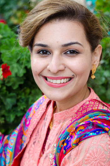Portrait of smiling beautiful woman in traditional cloths