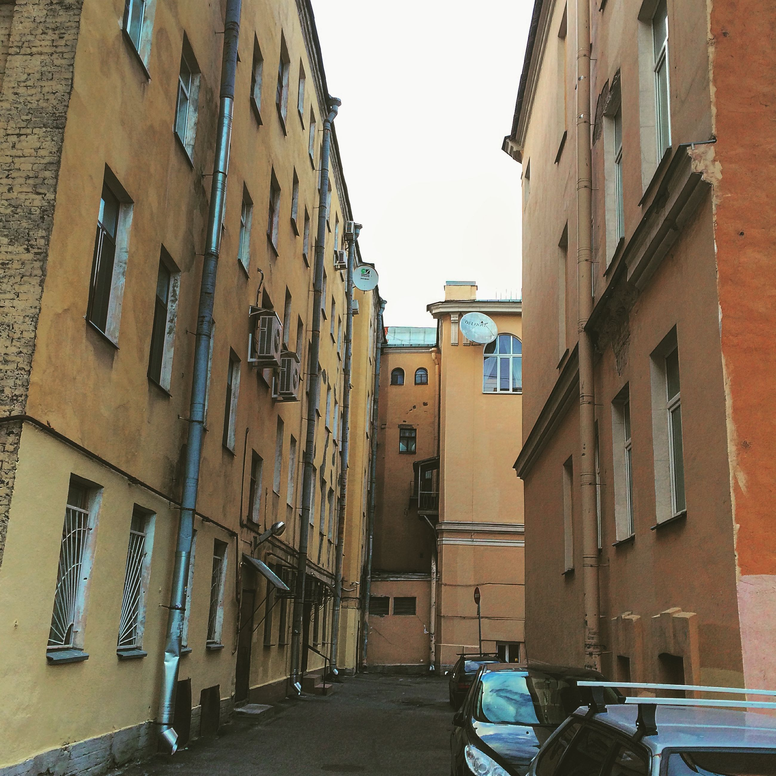building exterior, architecture, built structure, residential building, residential structure, building, window, street, city, clear sky, house, narrow, alley, residential district, day, low angle view, the way forward, outdoors, sky, town