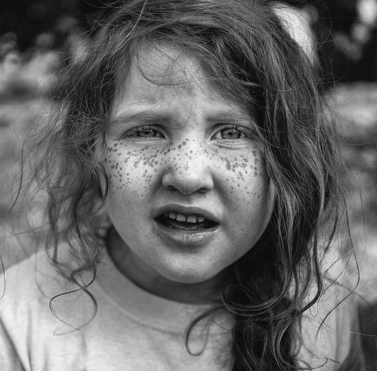 """Uniqueness I told her to look at me. She was like """"whuuut"""" One Girl Only Children Only Childhood Child Outdoors Portrait Happiness Close-up One Person People Day Black And White Portraits Uniqueness The Portraitist - 2017 EyeEm Awards"""