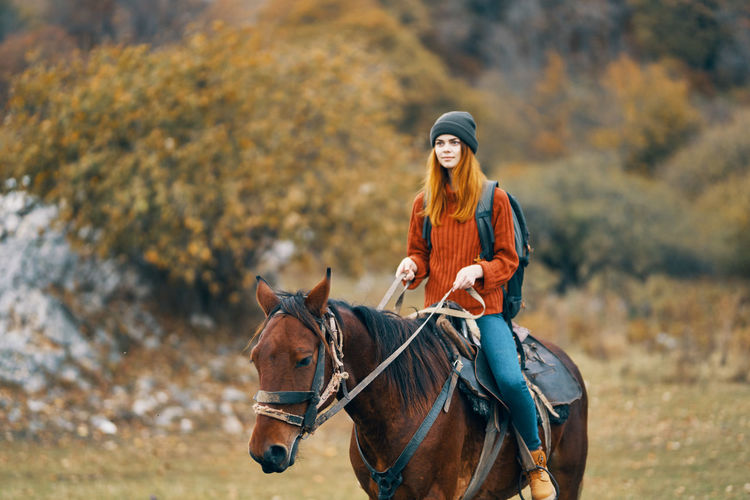 Portrait of a man riding horse