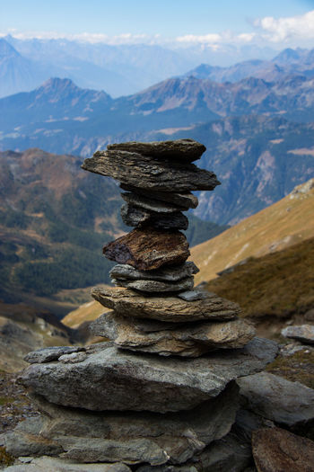 Mountain Stack Balance Mountain Range Tranquil Scene Tranquility Beauty In Nature Outdoors Distant Sky Cloud - Sky Travel Destinations Scenics Nature Italy Val D'Aosta Depth Of Field
