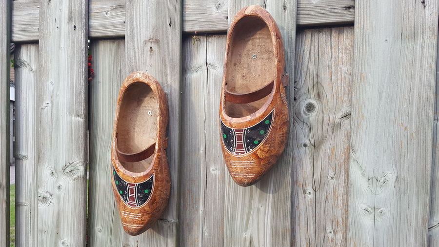Directly above shot of shoes hanging on wooden door