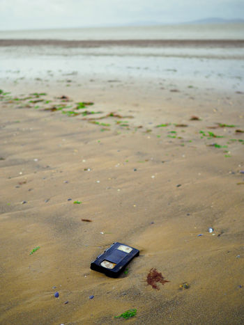 How we used to live Analogue Cumbria England UK Discarded VHS Beach Day History Litter Nature No People Outdoors Sand Sea Technology Video Tape Cassette Washed Up Be Kind Rewind