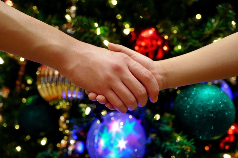 Moments Of Happiness Capture Tomorrow MerryChristmas Happiness Shaking Hands Handshake Hand Children Childhood Wish Light And Shadow Christmas Ornament Christmas Decoration Christmas Trees Human Hand Hand Human Body Part Two People Decoration Celebration Togetherness Illuminated Christmas Holiday Bonding Close-up Friendship Multi Colored Body Part Tree 2018 In One Photograph