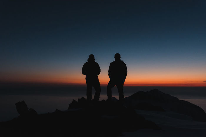 Me and my friend watching the sunset from the mountain we camped on that night Exploring Friends Travel Beauty In Nature Couple - Relationship Friendship Horizon Over Water Leisure Activity Lifestyles Men Nature Outdoors Real People Rock Rock - Object Scenics - Nature Sea Silhouette Sky Solid Standing Sunset Togetherness Two People Water