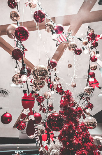 Low angle view of christmas decoration hanging on ceiling