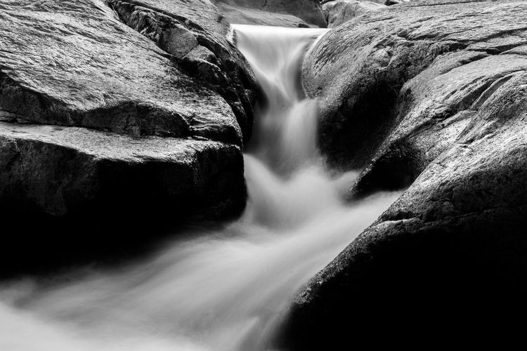 Timeless Beauty In Nature Blackandwhite Blackandwhite Photography Contrast Dark Darkness And Light Flowing Long Exposure Motion Outdoors Rock Rock - Object Rock Formation Stream Water Waterfall