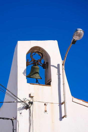 White bell tower with blue background. Bell Tower Architecture Old Traditional Traditional Architecture Blue White White And Blue Portugal Travel Vacation Bayside Love Traveling Visit Details In Close Up Decoration Clear Sky Blue Sky Building Exterior Historic Building Tall Historic